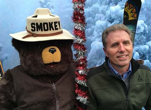 Mayor Michael Gamba and Smokey Bear pose for a picture.